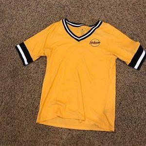 yellow, black, and white varsity shirt